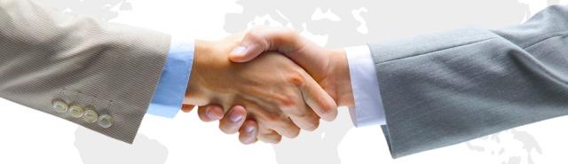 bigstock-Handshake-with-map-of-the-world-header