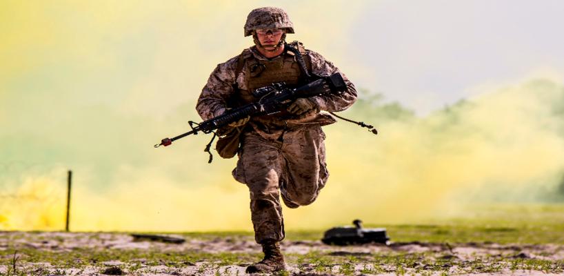 Marine runs to cover - USMC photo from DoD