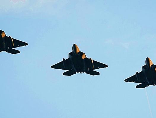 Raptor triple play - USAF photo